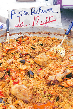 Regain strength from last night! Paella provençal at the summer market in Port Grimaud, Provence, France.