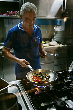 Chef at work in the kitchen of the restaurant 1999, Maratea, Basilicata, Italy, Europe