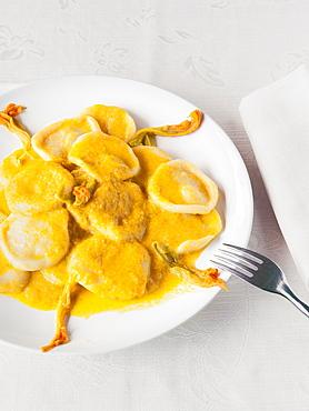 Hand made pasta with zucchini flowers souce and fresh zucchini flowers, Il Giardino Di Epicuro restaurant, Maratea, Basilicata, Italy, Europe