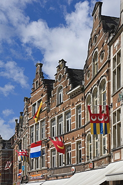Traditional gabled facades decorated with heraldic banners, Oude Markt, Leuven, Belgium, Europe