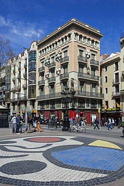 A mosaic pavement by Miro and building decorated with Umbrellas, on Las Ramblas, Barcelona, Catalunya, Spain, Europe