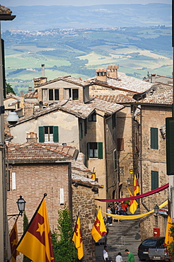 Medieval street decorated with local area flags, Montalcino, UNESCO World Heritage Site, Val d'Orcia, Tuscany, Italy, Europe