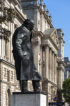 Statue of Sir Winston Churchill, Parliament Square, Parliamentary Buildings in background, London, England, United Kingdom, Europe