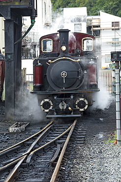 Narrow gauge Blaenau Ffestiniog railway station engine taking water and coal, Porthmadog, Llyn Peninsular, Gwynedd, Wales, United Kingdom, Europe