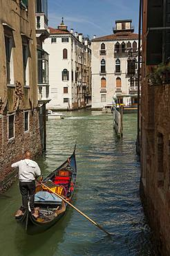 Gondola and gondolier, Side canal, Venice, UNESCO World Heritage Site, Veneto, Italy, Europe