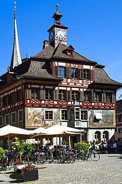 Rathaus (Townhall), cyclists, Stein am Rhein, Canton of Schaffhausen, Switzerland, Europe