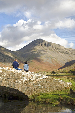 Two walkers pause, looking to Great Gable 2949ft, Wasdale Valley, Lake District National Park, Cumbria, England, United Kingdom, Europe