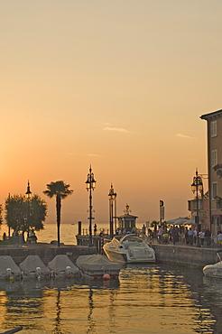 Evening light, harbour entrance, Lazise, Lake Garda, Veneto, Italian Lakes, Italy, Europe