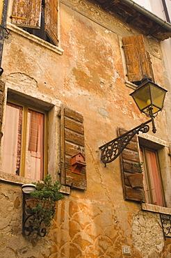 Old wall with shuttered windows, Lazise, Lake Garda, Veneto, Italy, Europe