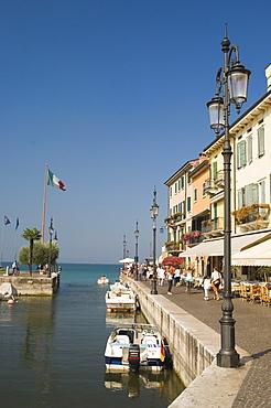 Harbour entrance and quayside cafes, Lazise, Lake Garda, Veneto, Italy, Europe