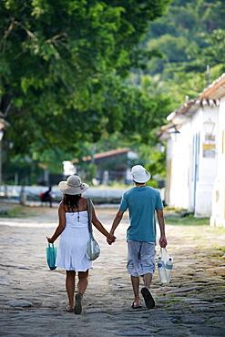 Couple walking in the historic part Paraty (Parati), Rio de Janeiro State, Brazil, South America
