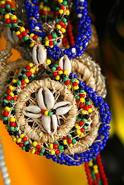 Candomble wear strings of beads made of seeds and shells in the colours of African gods. Cachoeira, Bahia, Brazil.
