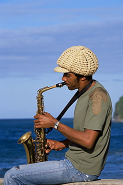 Sylvere Taverny playing a saxophone at Grand Riviere fishing village in the norther tip of the island, Martinique, Lesser Antilles, West Indies, Caribbean, Central America