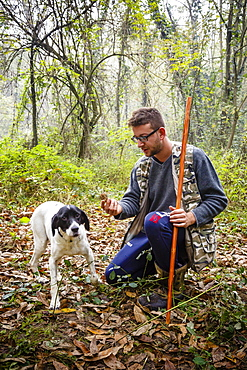 Truffle hunter with his dog, Langhe, Cueno, Piedmont, Italy, Europe