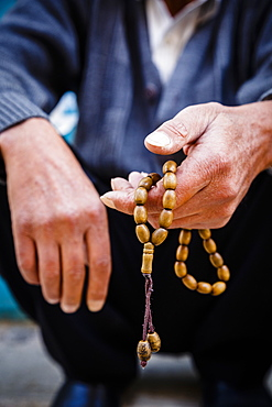 Hands holding worry beads, Bethlehem, West Bank, Palestine territories, Israel, Middle East