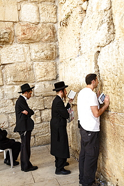 Orthodox Jewish people praying at the Western Wall (Wailing Wall), Jerusalem, Israel, Middle East