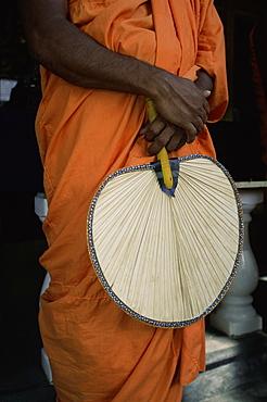 Buddhist monk with fan, Sri Lanka, Asia