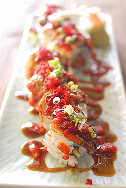 Plate of sushi rolls with hot sauce, Japan, Asia