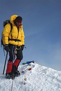 Man on summit of Mount Denali, 20320 ft, Alaska, United States of America, North America