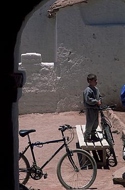 Boy and bike, San Pedro de Atacama, Chile, South America