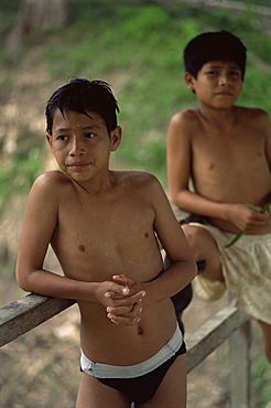 Local boys hang out on bridge after jumping off it, Amazon River, Peru, South America