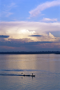Small fishing boat moving down giant river, Amazon River, Peru, South America