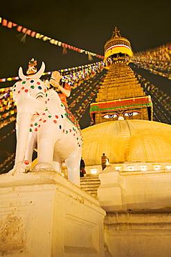 Tibetan Buddhist stupa, Boudha, Bodhnath, lit by votive candles on a winter night, Kathmandu, Nepal, Asia