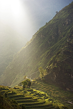 Sunset over high terraced hills, close to Tibet on the trade route above the Arniko river, Nepal, Asia