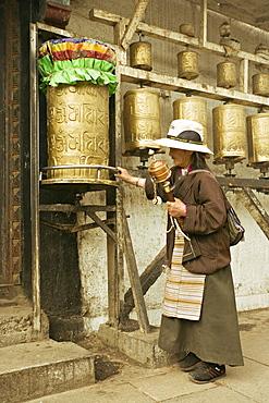 Woman circuits the inner Jokhang temple, walking the circumambulation pathway (Nangkhor), Jokhang temple, Barkhor, Lhasa, Tibet, China, Asia
