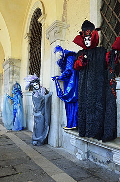 Masked figures in costume at the 2012 Carnival, Venice, Veneto, Italy, Europe