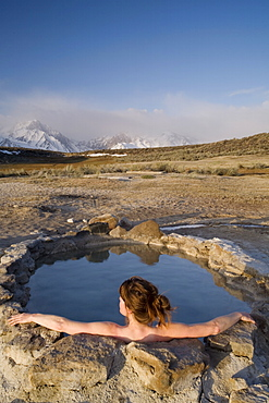 Woman relaxing in hot spring, Mammoth Lakes region, California, United States of America, North America