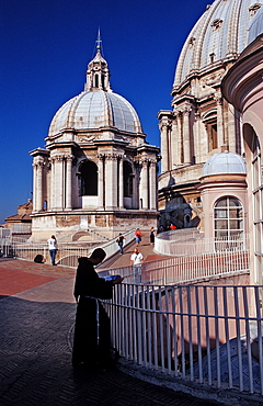 Catholic priest on St Peters Basilica, Italy, Rome, Vatican City