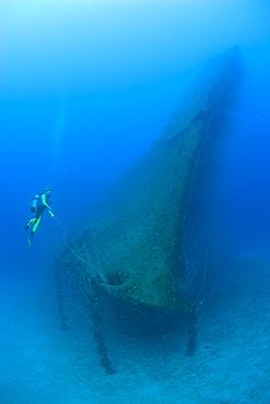 Diver at Bow of USS Arkansas Battleship, Marshall Islands, Bikini Atoll, Micronesia, Pacific Ocean