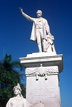 A statue of Jose Marti (poet and martyr of the Cuban independence movement) in the Plaza Marti in the town of Cienfuegos, Cienfuegos Province, Cuba