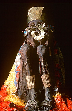 Precolumbian Gold Nazca Culture, 100-700AD mummy with gold ornaments and wrapped in feather blanket in collection of the Museo del Oro, Lima, Peru