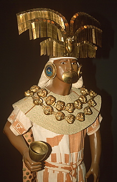 Gold Artifacts Moche (Mochica) Culture, 100 to 700AD, NCoast Lord of Sipan Tomb, c300AD model of Lord's attendant in ornaments of gold and turquoise, Peru