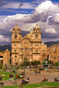 Ancient capital of the Incas the Plaza de Armas in the colonial center of the city with the baroque La Compania Church, c1571, Cuzco, Highlands, Peru