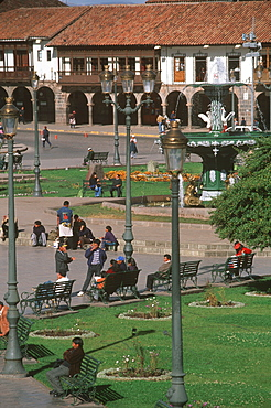 Ancient capital of the Incas the Plaza de Armas in the colonial center of the city with fountain and arcaded buildings beyond, Cuzco, Highlands, Peru