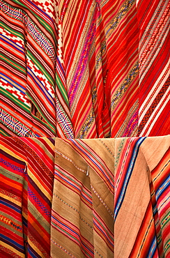 Pisac village in Sacred Valley of the Incas near Cuzco and famous for one of the world's most colorful markets traditional textiles, Highlands, Peru