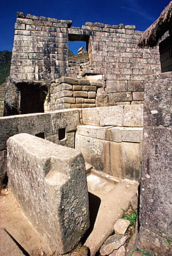 Machu Picchu skillfully carved, stone wall of the Sun Temple, with fountains and water channels in foreground, Highlands, Peru