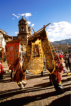 Corpus Christi is one of Peru's most famous festivals with thousands in procession in 's Plaza de Armas carrying banners, Cuzco, Peru