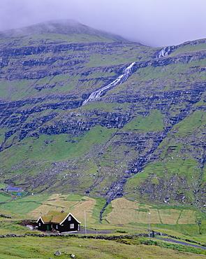Traditional turf roofed house and hills at Saksun, Streymoy Island, Faroe Islands (Faroes), Denmark, Europe