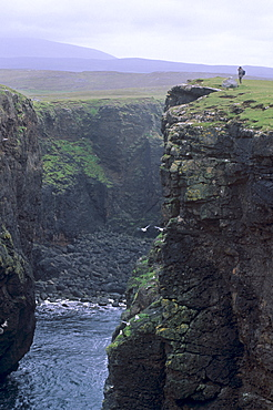 Eshaness basalt cliffs, Calder's Geo, ancient volcanic crater, coast deeply eroded with caves, blowholes and stacks, Northmavine, Shetland Islands, Scotland, United Kingdom, Europe
