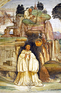 Frescoes in cloister by High Renaissance painter Il Sodoma (Giovanni Antonio Bazzi) painted between 1505 and 1508, of the life of St. Benedict (San Benedetto), showing St. Benedict receiving his Easter meal from a monk, Monte Oliveto Maggiore Abbey, Chiusure, Tuscany, Italy, Europe