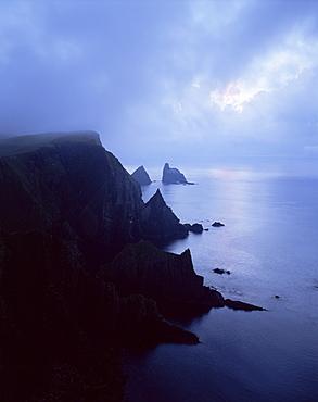North coast of Fair Isle, with Stack of Skroo in mist in the distance, Fair Isle, Shetland Islands, Scotland, United Kingdom, Europe
