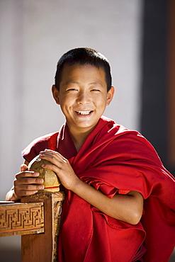 Young Buddhhist monk, Punakha Dzong, Punakha, Bhutan, Asia