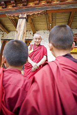 Buddhist lama teaching young monks, Karchu Dratsang Monastery, Bumthang, Bhutan, Asia