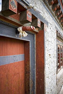 Phallus above house door to ward off evil spirits, Jankar, Bumthang Valley, Bhutan, Asia