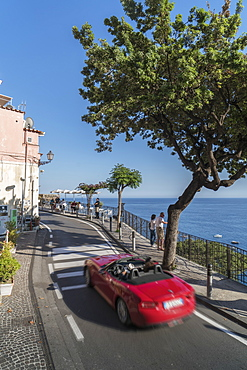 Red sport car on the narrow street of Amalfi Coast, UNESCO World Heritage Site, Campania, Italy, Europe