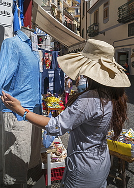 Woman shopping in the streets of Amalfi, on the Amalfi Coast, Campania, Italy, Europe